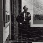 Marcel Duchamp [1942] Behind Mile of String. First Papers of Surrealism, New York. Photo by Arnold Newman.