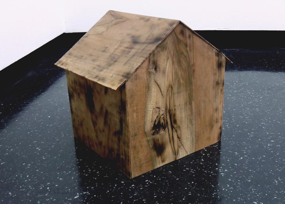 Maria Christoforatou [2012] There's no home for you here. Walnut wood, sound, 30 x 26.7 x 26.1cm. Installation view, Art on fire, Camberwell College of Arts, London, 2012.